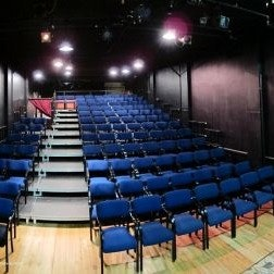 The audience in the Studio (will remove 5 rows of 2 and risers on HOUSE RIGHT)