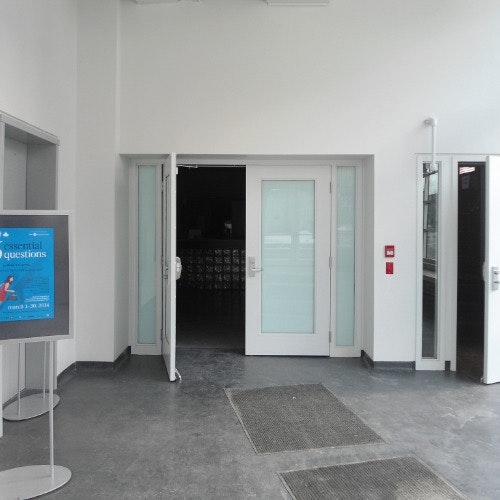 The entrance to the Studio from within the glass atrium.